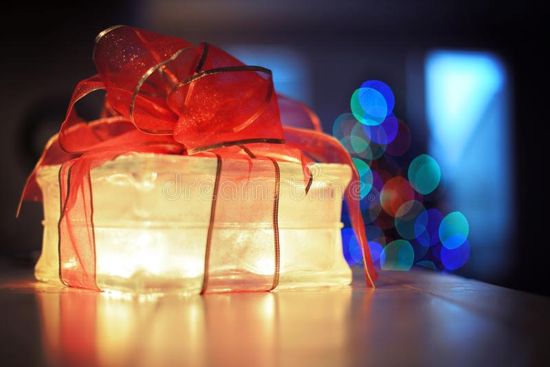 Illuminated gift with bow royalty free stock photography