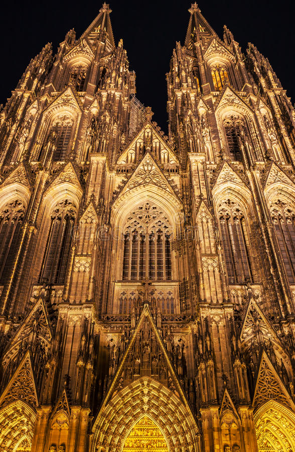 Illuminated Gothic Cologne Cathedral at Night, Germany stock images