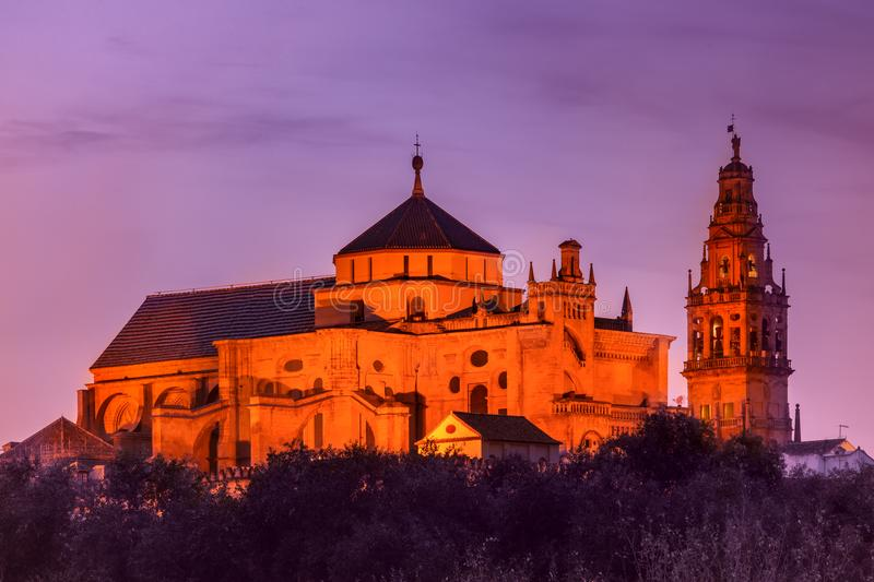 Illuminated Great Mosque Mezquita, Cordoba, Spain. Illuminated Great Mosque Mezquita - Catedral de Cordoba during evening blue hour, Cordoba, Andalusia, Spain royalty free stock photos