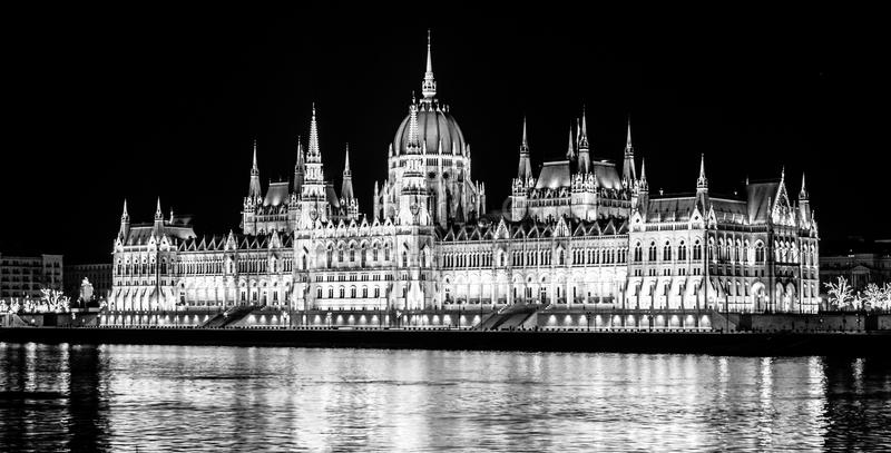 Illuminated historical building of Hungarian Parliament on Danube River Embankment in Budapest by night royalty free stock images