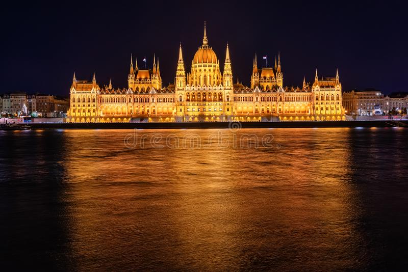 Illuminated historical building of Hungarian Parliament at night on Danube River Embankment. Illuminated historical building of Hungarian Parliament at night on stock photography