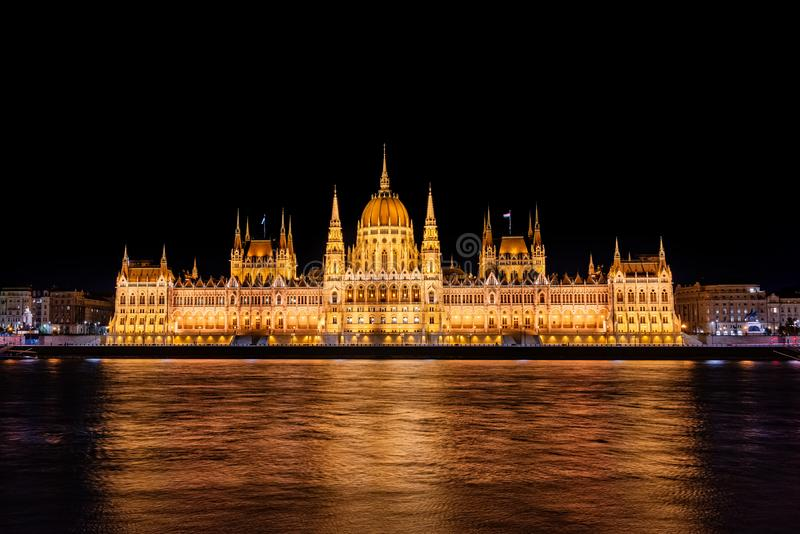 Illuminated historical building of Hungarian Parliament at night on Danube River Embankment. Illuminated historical building of Hungarian Parliament at night on stock image