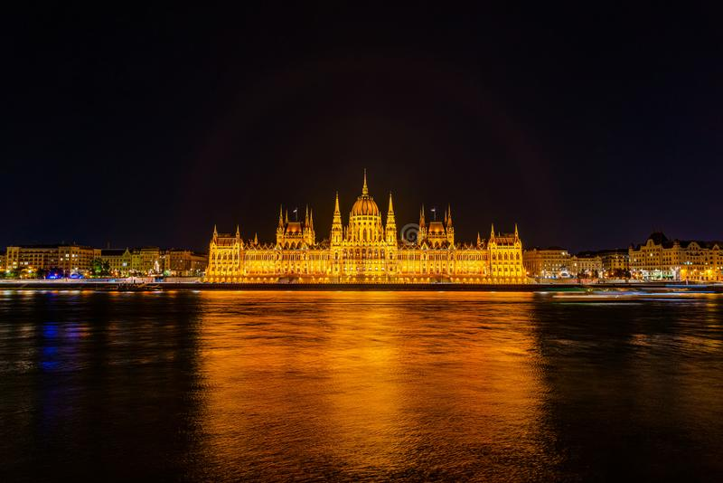 Illuminated historical building of Hungarian Parliament at night on Danube River Embankment. Illuminated historical building of Hungarian Parliament at night on stock photo