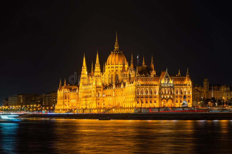 Illuminated historical building of Hungarian Parliament at night on Danube River Embankment. Illuminated historical building of Hungarian Parliament at night on royalty free stock images