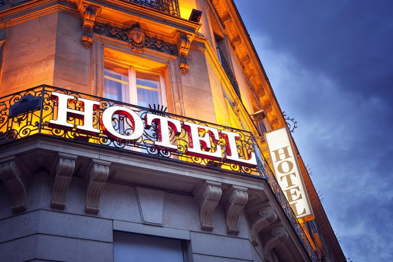 Illuminated hotel sign in Paris at night stock photography