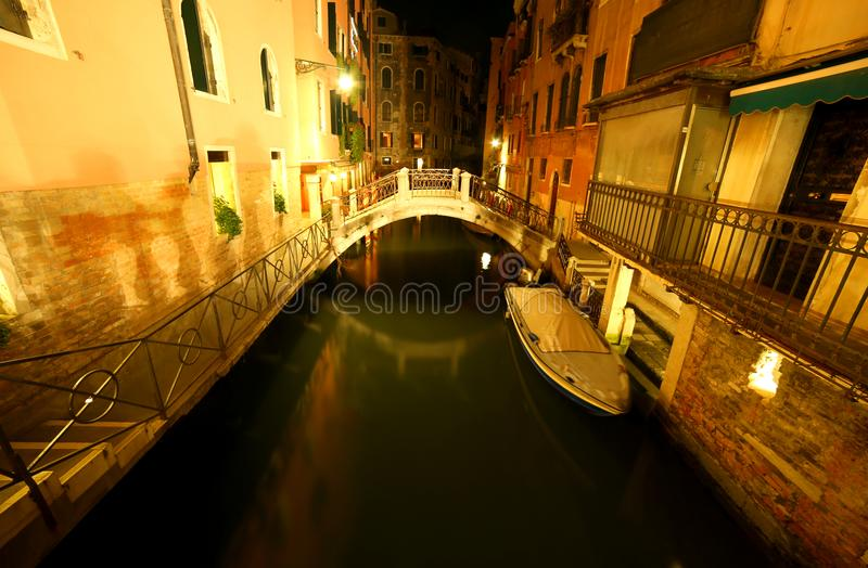 illuminated houses and the canal of VENICE in Italy at night royalty free stock photos
