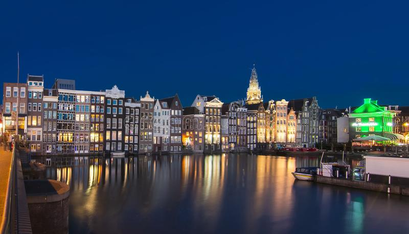Houses on Damrak canal at night, Amsterdam, Netherlands royalty free stock images