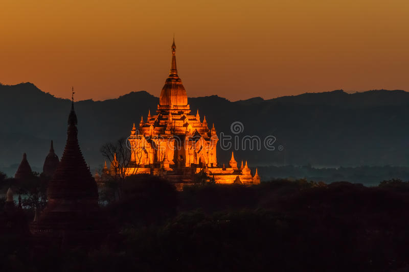Download The Illuminated Htilominlo Temple At Sunset Stock Image - Image of monastery, landmarks: 59948855