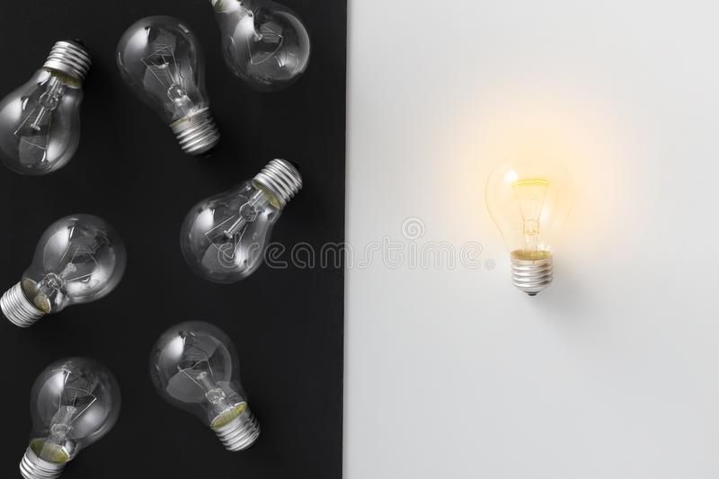 Illuminated lamp separated from other on contrast background stock photo