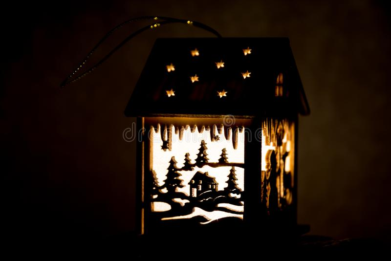 Illuminated lantern with winter motive stock photography
