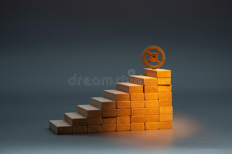 Illuminated by light from above the step at the top of the stairs and the gear in the same place royalty free stock photos