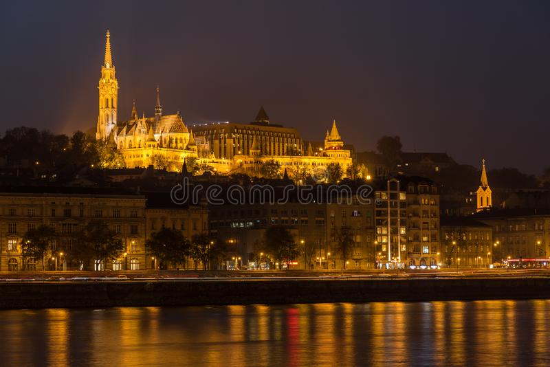 Matthias Church and the Danube River at Night, Budapest, Hungary. Illuminated Matthias Church with the Danube River in Budapest at night, Hungary, Europe stock photos