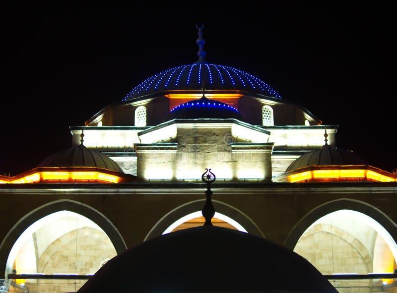Illuminated mosque at night stock photo