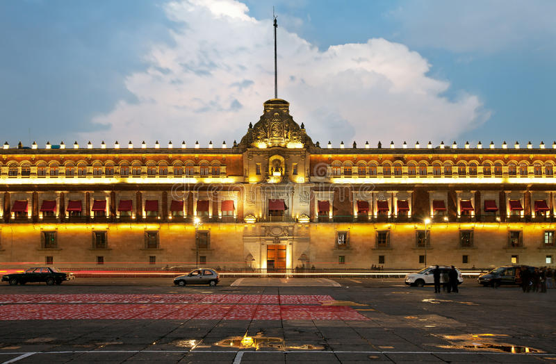 Illuminated National Palace in Zocalo of Mexico City. Illuminated National Palace in Plaza de la Constitucion of Mexico City at sunset. Zocalo and Army Square royalty free stock photography