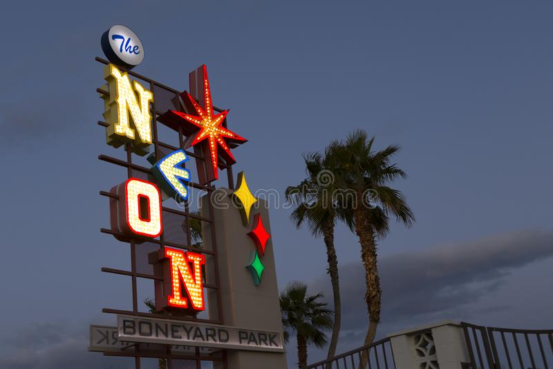 The illuminated Neon Boneyard Park sign designed in a vintage style for the Neon Museum. Seen at dusk, Las Vegas, Nevada, USA stock photos