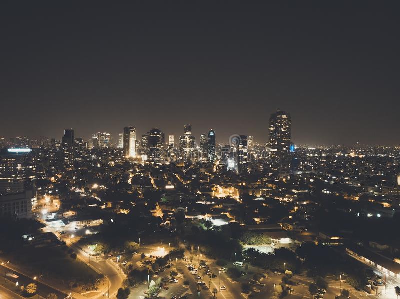 Illuminated night city, Tel aviv, Israel. Residential districts and business centre of metropolis shot at night. City lights,. Illuminated night city, Tel aviv royalty free stock images