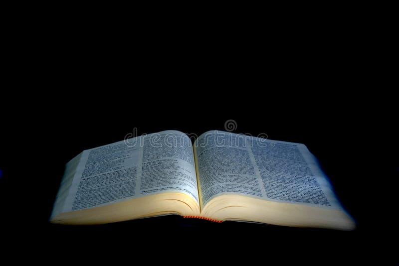Illuminated open Bible royalty free stock image
