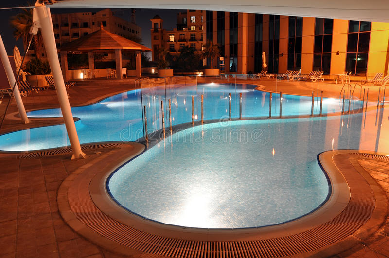 Download Illuminated Poolside At Night Stock Image - Image of curve, pool: 17232817
