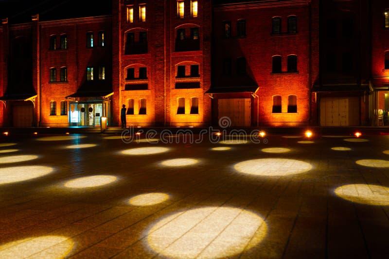 Illuminated red brick warehouse in the spotlight. Shooting location : Budapest royalty free stock image