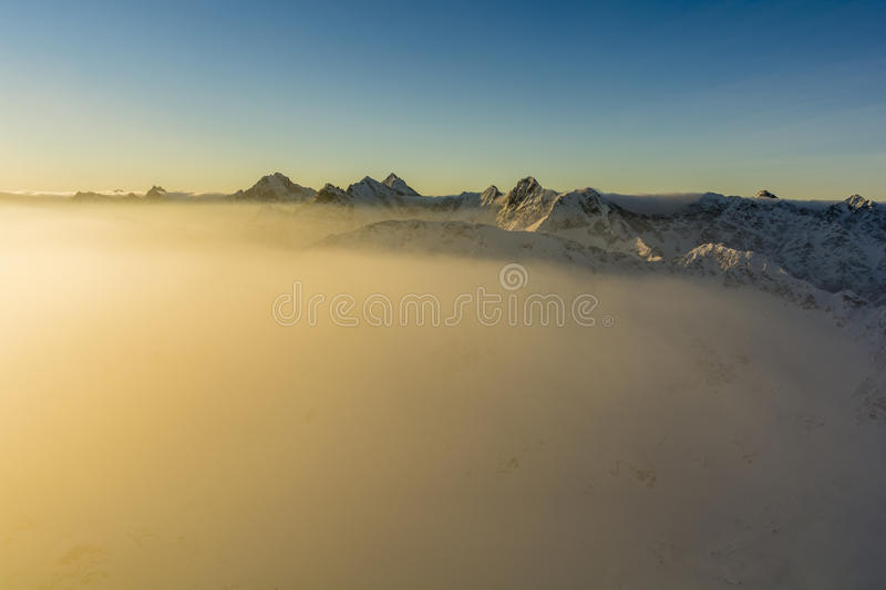 Illuminated by the rising sun fog clouds. stock images