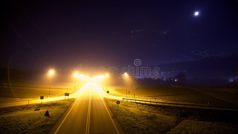 Illuminated roadway at night stock images