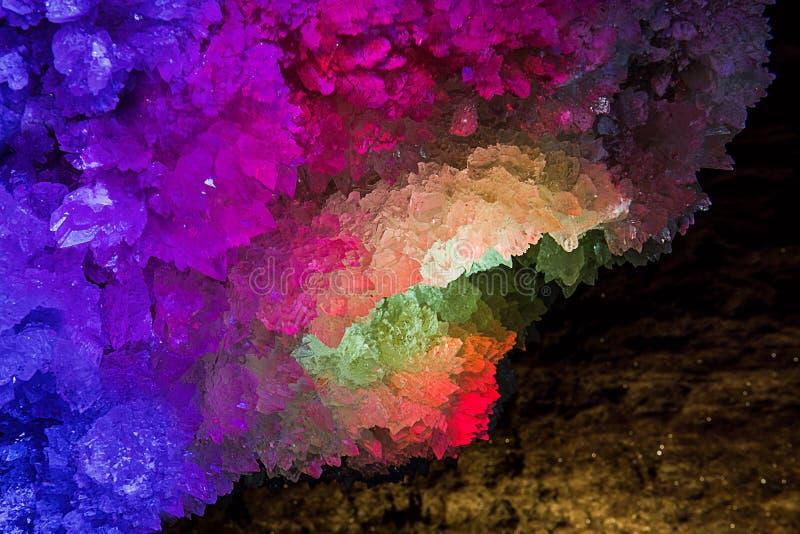 Illuminated rock crystal. Mlynky Cave, Ukraine stock image