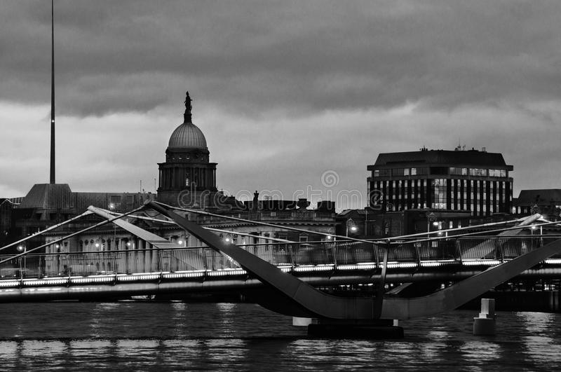 Illuminated Sean O`Casey Bridge with the Custom House in Dublin, Ireland at night. Black and white royalty free stock images