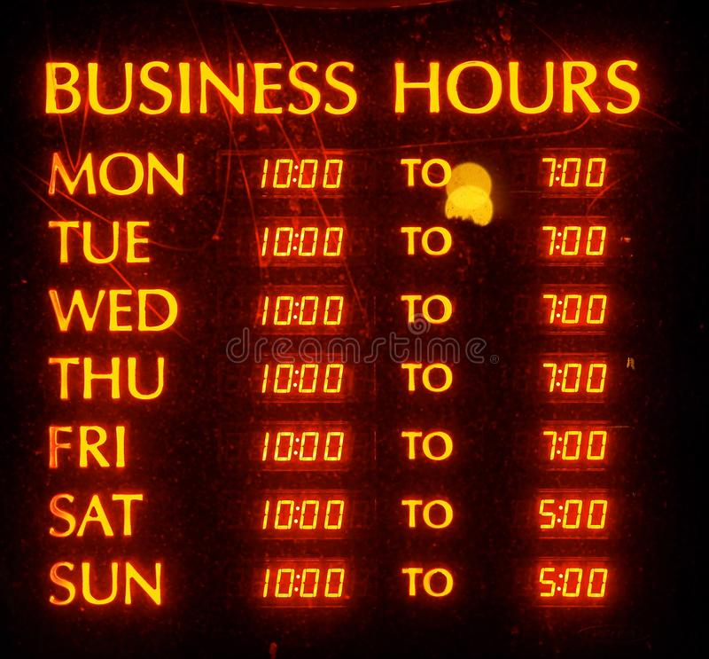 Illuminated Sign Of Operating Hours royalty free stock images