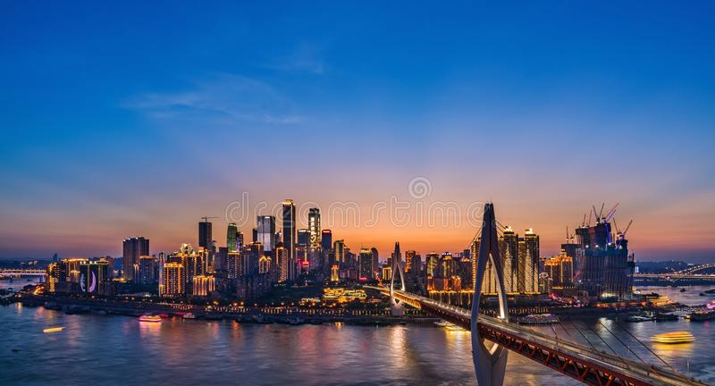 Chongqing Night Skyline. Illuminated sign with the word `Hello, Chongqing! Hello, World` on the top of WFC of Chongqing, China royalty free stock photos