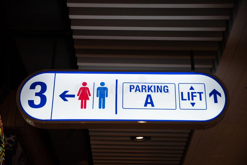 Illuminated signboard Level, toilet, parking and lift. In shopping mall royalty free stock photo