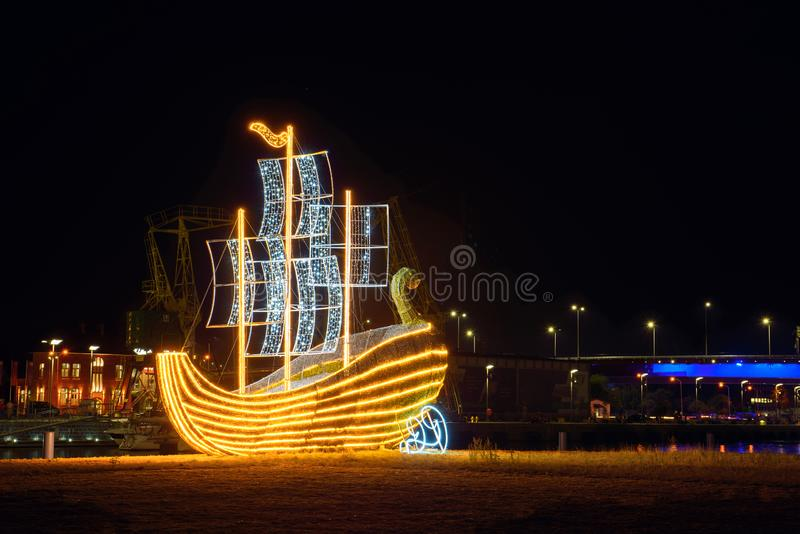 Illuminated straw ship located in the city. Szczecin at night, boat, cruise, liner, luxury, reflection, sail, sea, travel, vacation, water, harbor, light royalty free stock photo
