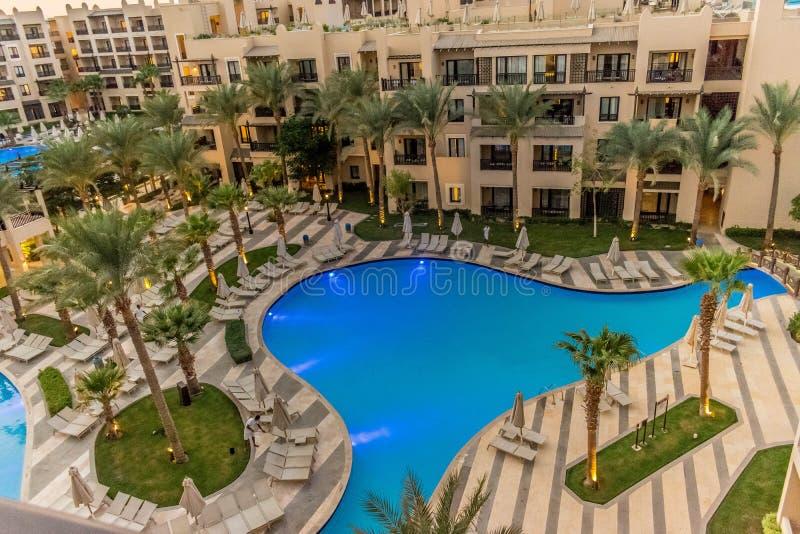 Illuminated swimming pool in an Egyptian hotel stock photos