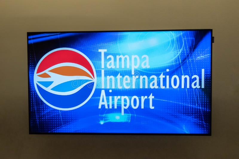Illuminated Tampa International Airport logo on screen. royalty free stock images