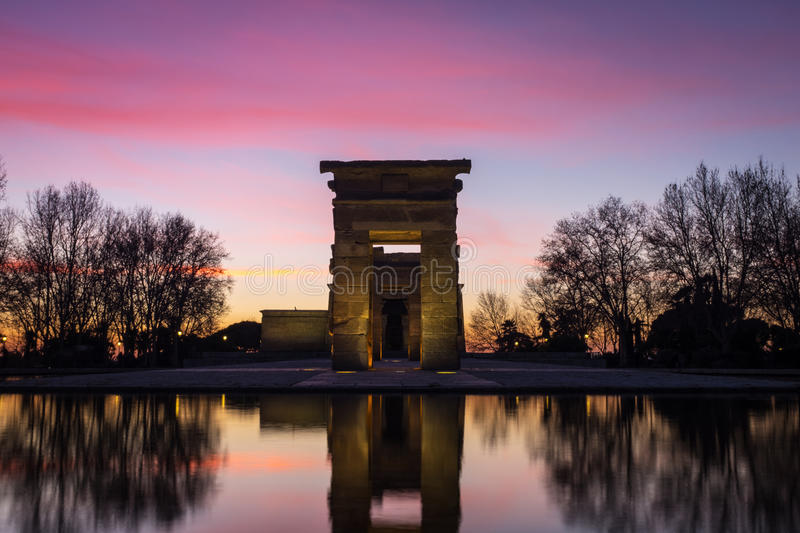 Illuminated Temple of Debod and reflection during sunset in Madrid. Ancient Temple of Debod and reflection during a pink sunset in Madrid. This ancient Egyptian royalty free stock photos