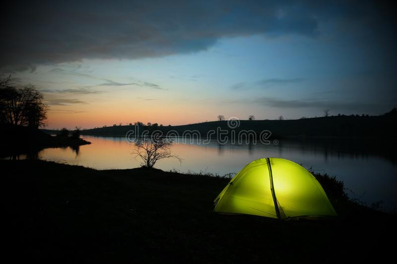 Illuminated tent by the Biviere lake in Nebrodi Park royalty free stock photography