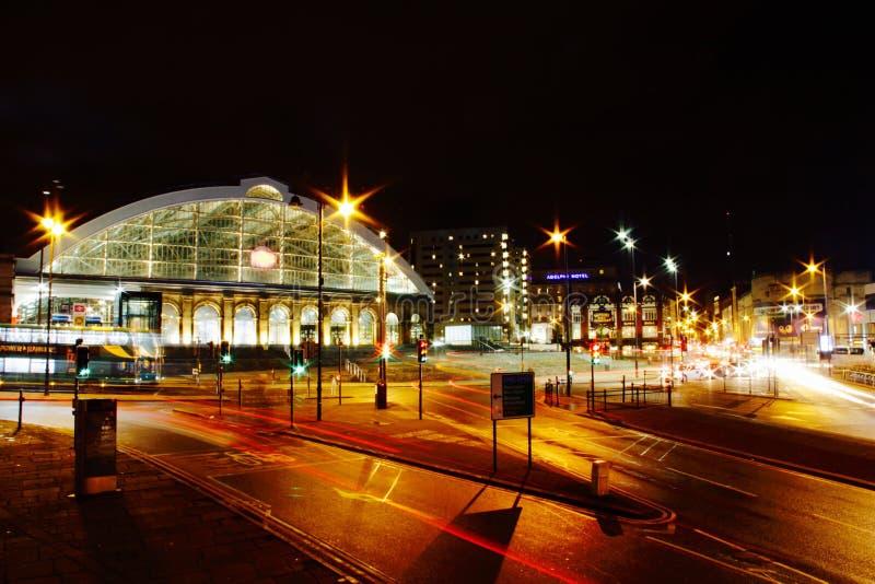 Illuminated train station at night stock images