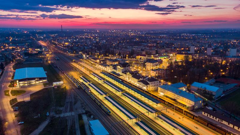 Illuminated train station in Tarnow,Poland.Aerial view. At twilight blue building city life cityscape colorful downtown drone dusk europe evening above historic royalty free stock photo