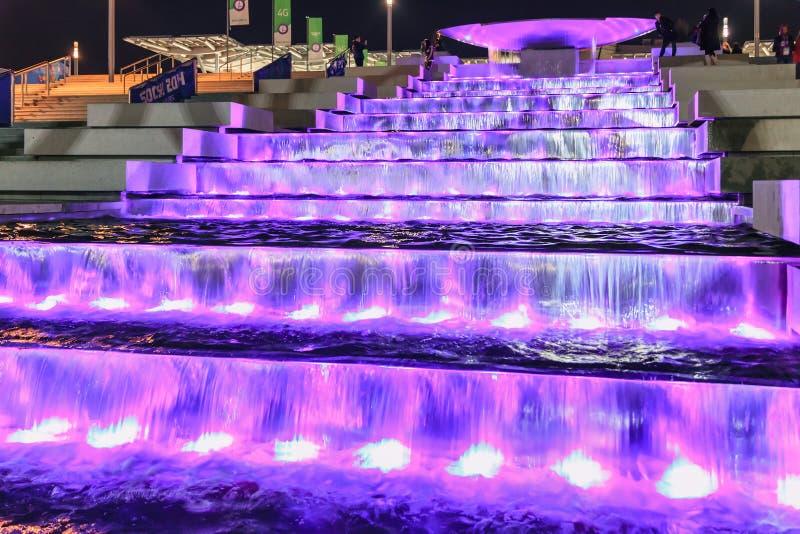 Illuminated waterfall fountain cascade by Olympic Park enchants with its beautiful play of water and light. Sochi, Russia - February 10, 2014: Illuminated royalty free stock photos