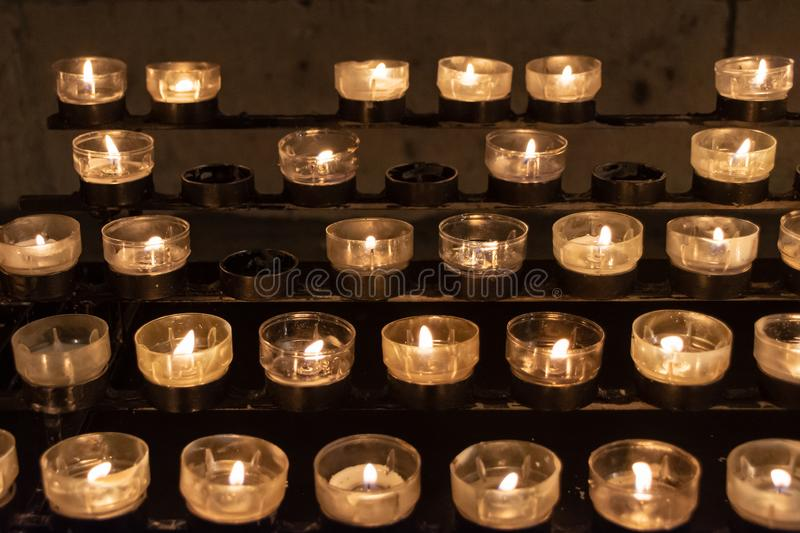 Illuminated Yellow Candles in Cologne cathedral church, Christmas night, Germany. Illuminated Yellow Candles in many rows in Cologne cathedral church during royalty free stock photo