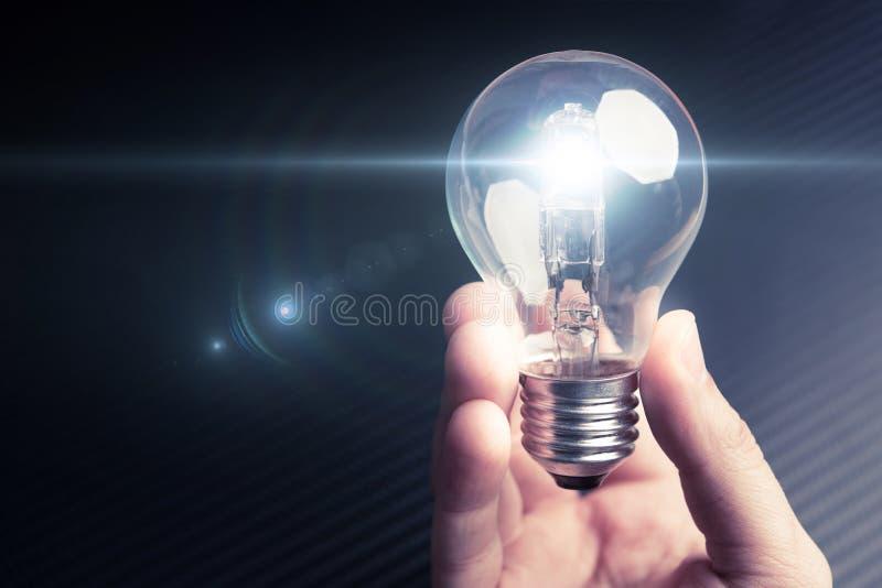 Illuminating bulb in mens hand. Future technology idea concept. royalty free stock photos