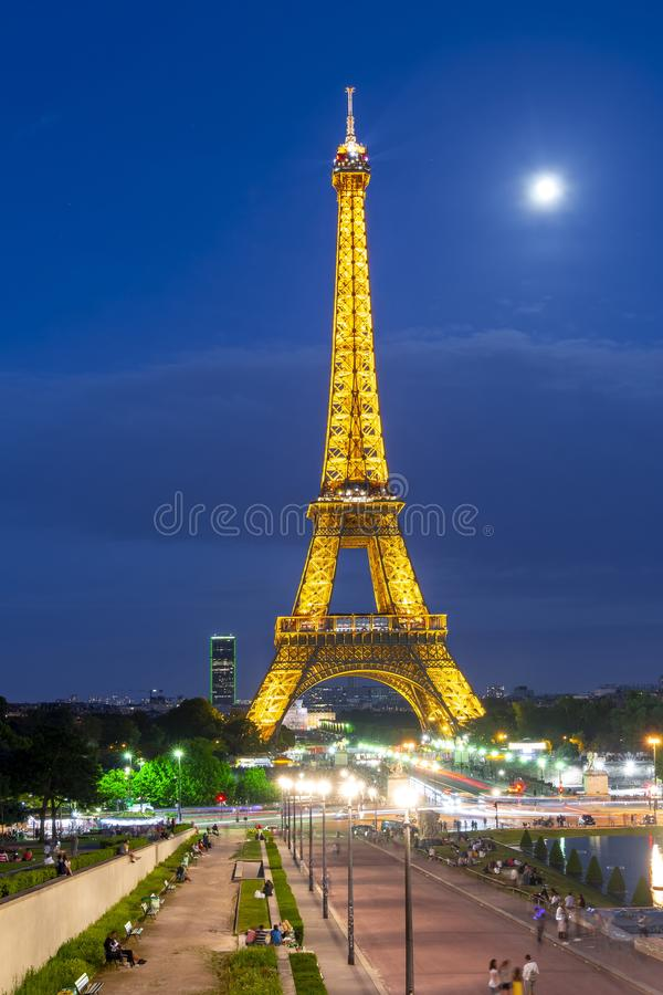 Illumination of Eiffel tower at night, Paris, France stock photography