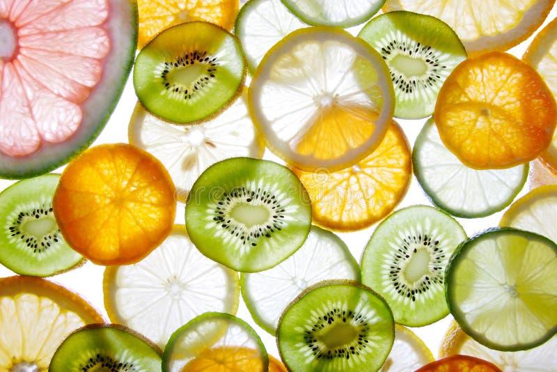 Illumini le fette dell'agrume fotografia stock
