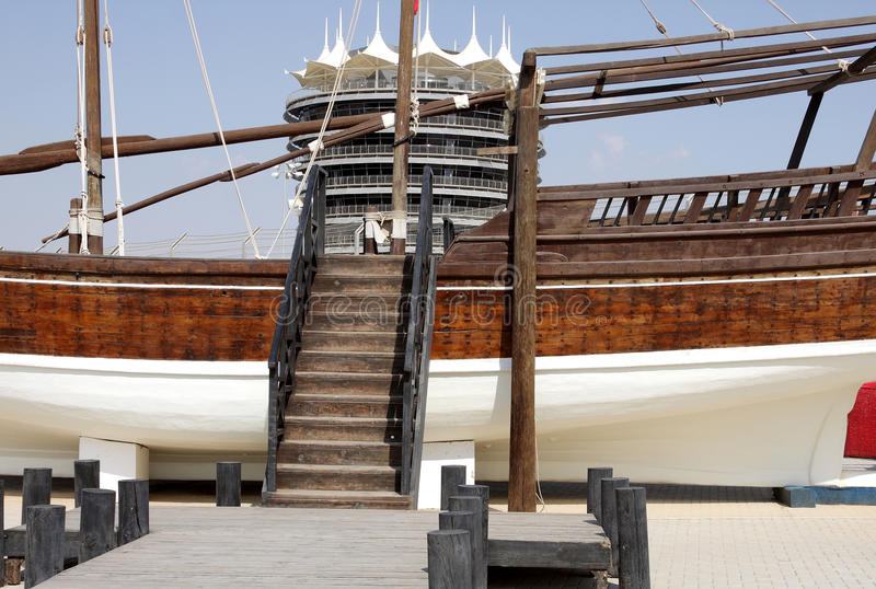 An illusion showing stairs to climp on VIP tower. Traditional fishing boat kept at the venue of Formula 1, Bahrain International Circuit stock photography