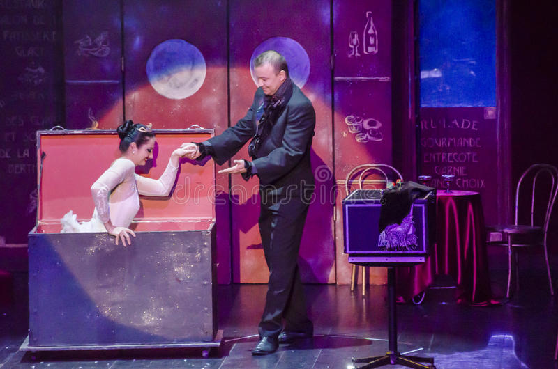 Illusionist and his assistant royalty free stock images