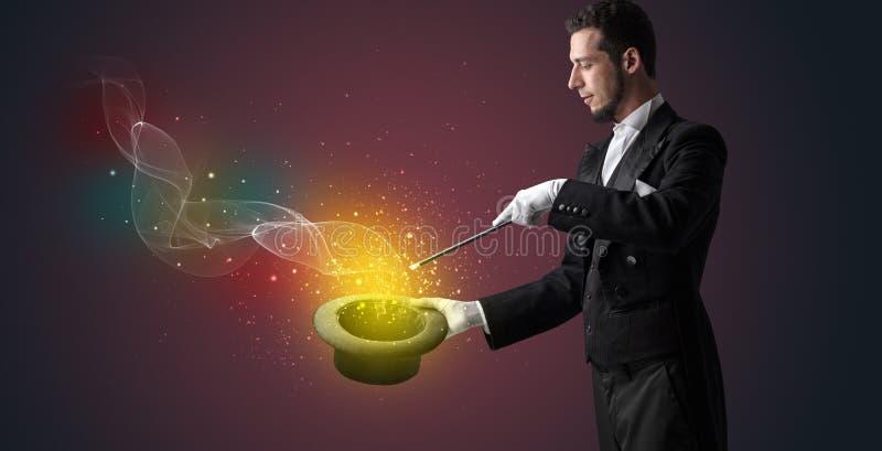 Illusionisthand die truc met toverstokje maken stock afbeelding