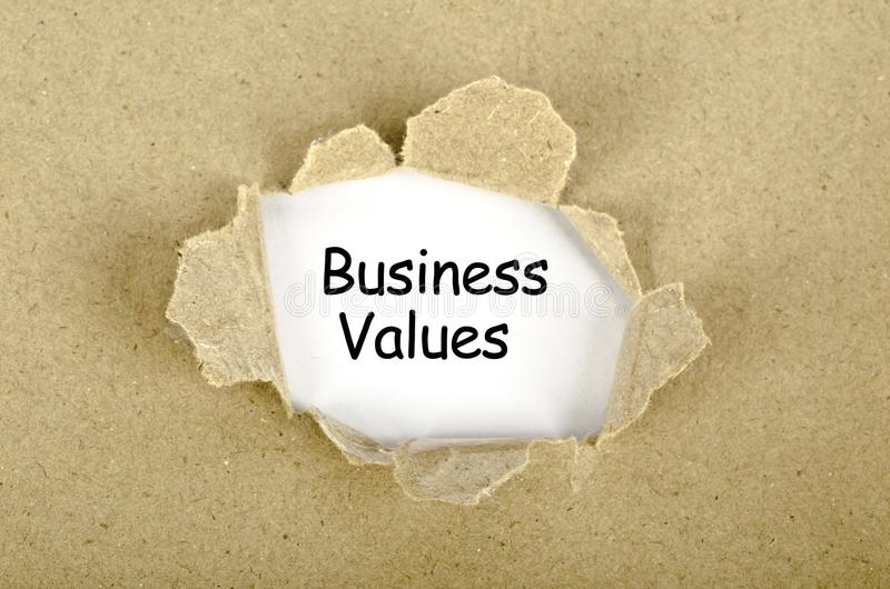 Business values word written on a torn paper hole stock illustration