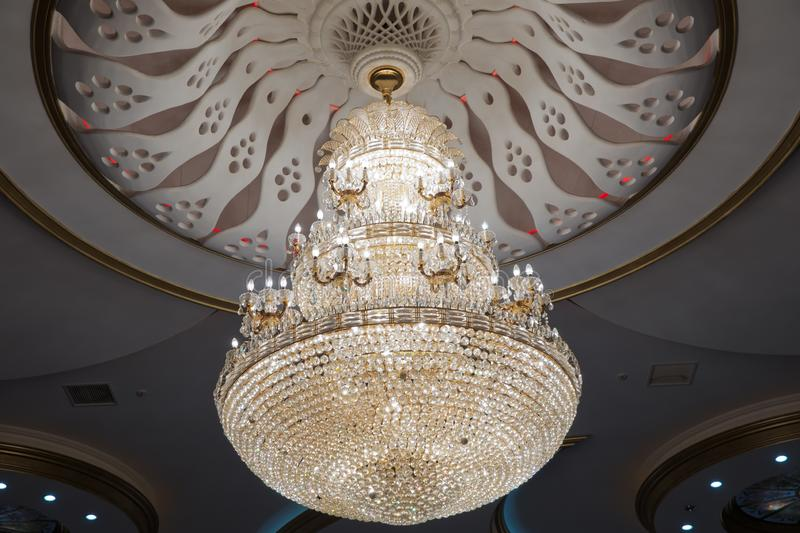 Illustration of a chandelier with crystal pendants on the black . Palace ball hall for dancing, ballroom. Big and old expensive royalty free stock images