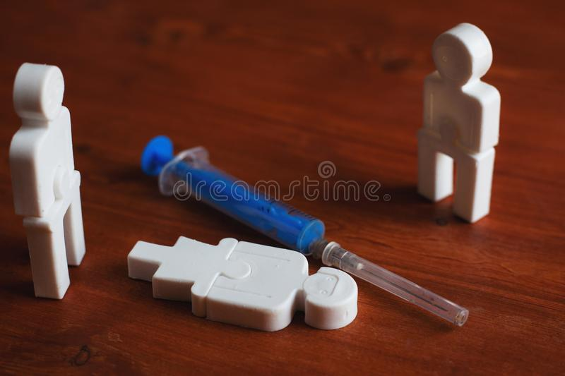 Illustration of drug addiction of people, plastic people with a syringe stock photography