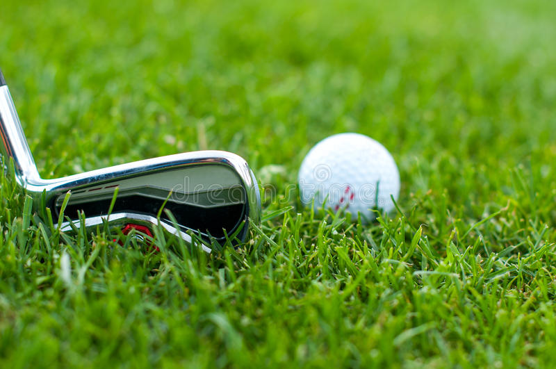 Illustration of a golf ball on a green meadow stock photos