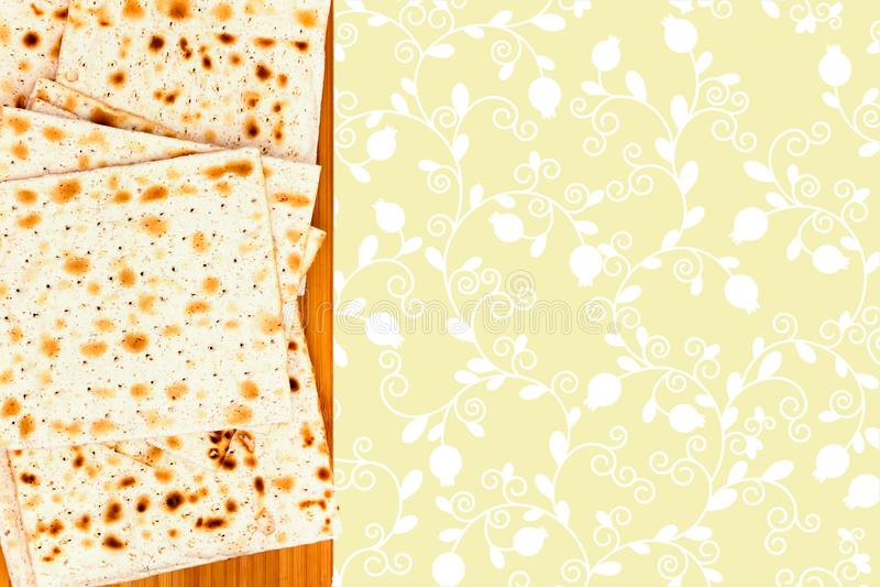 The illustration of matzah for jewish passover. An overhead photo of Jewish matza on the wooden chopping board. Holiday illustrati stock photo